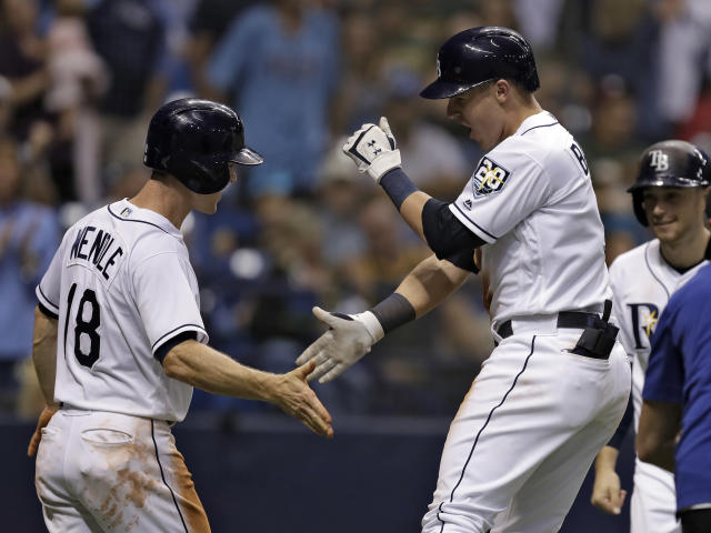 Tampa Bay Rays' Jake Bauers, center, celebrates with Joey Wendle, left, and Brandon Lowe, right, after Bauers hit a three-run home run off Oakland Athletics pitcher Jeurys Familia during the eighth inning of a baseball game, Saturday, Sept. 15, 2018, in St. Petersburg, Fla. (AP Photo/Chris O'Meara)