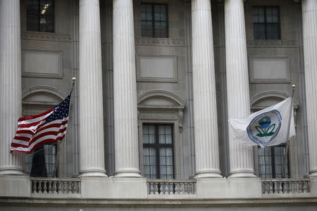 Flags fly outside the U.S. Environmental Protection Agency (EPA) at EPA headquarters in Washington, U.S., July 11, 2018. REUTERS/Ting Shen