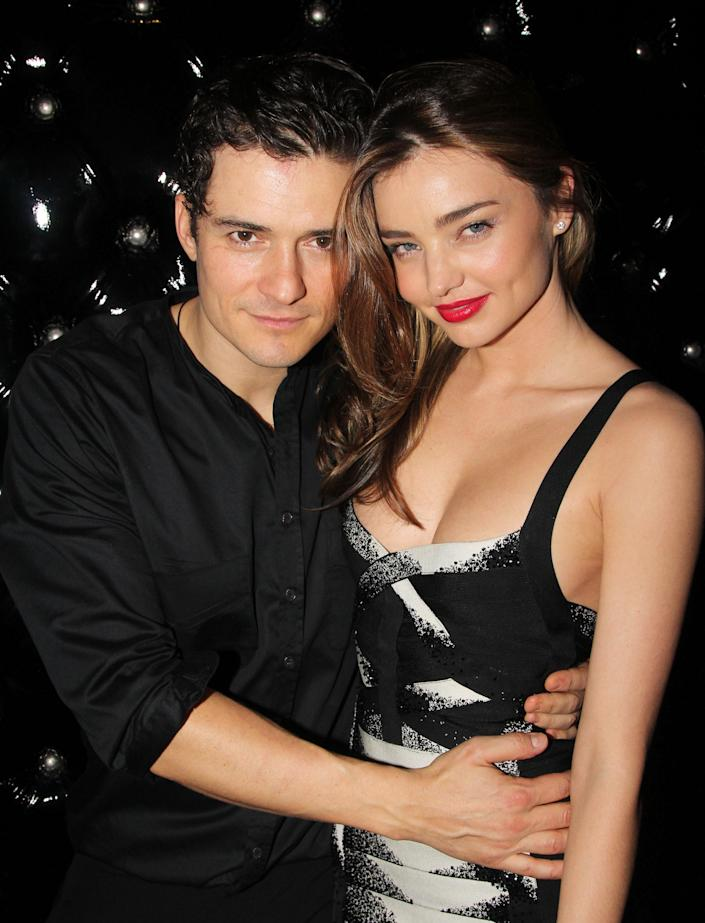 """Orlando Bloom and then-wife Miranda Kerr attend the after party for the Broadway opening night of 'Shakespeare's Romeo And Juliet' at The Edison Ballroom on September 19, 2013 in New York City. <span class=""""copyright"""">Photo by Bruce Glikas/FilmMagic via Getty Images</span>"""