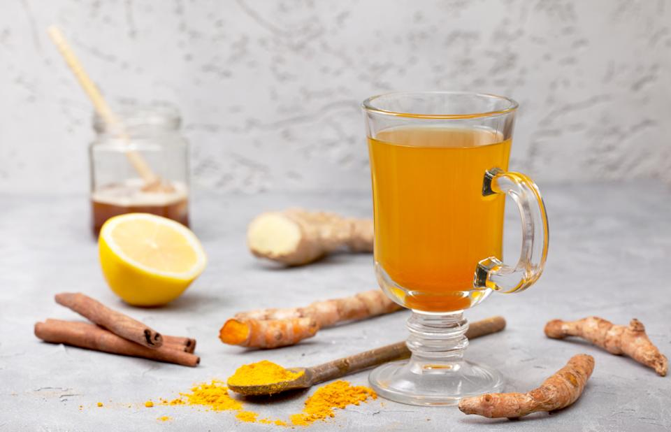 Boil 2 cups of water and add a tablespoon of grated ginger and 1/2 a teaspoon of turmeric powder.