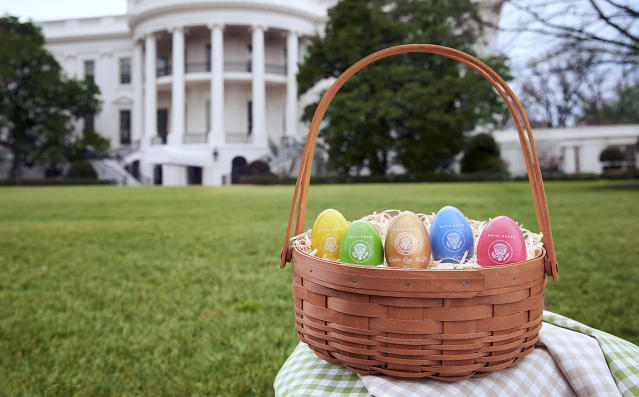 <p>In this 2018 photo provided by the White House Historical Association, colorful eggs created at Maine Wood Concepts in New Vineyard, Maine, are displayed outside the White House in Washington. Some of the 110,000 keepsakes created for the association will be used in the White House Easter Egg Roll on Monday, April 2. (Photo: David Wiegold/White House Historical Association via AP) </p>