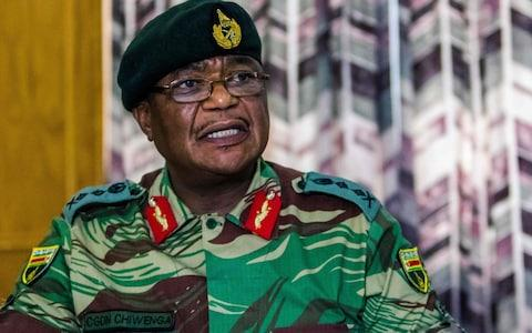 Zimbabwe Army General Constantino Chiwenga Commander of the Zimbabwe Defence Forces addresses a media conference held at the Zimbabwean Army Headquarters on November 13, 2017 in Harare - Credit:  AFP