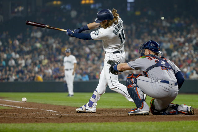 Seattle Mariners' Ben Gamel hits an RBI-single to score Denard Span against the Houston Astros during the eighth inning of a baseball game, Tuesday, Aug. 21, 2018, in Seattle. (AP Photo/Jennifer Buchanan)