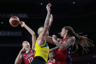 Australia's Cayla George (15) is blocked as she drives to the basket against United States's Diana Taurasi (12) and Brittney Griner (15) during a women's basketball quarterfinal game at the 2020 Summer Olympics, Wednesday, Aug. 4, 2021, in Saitama, Japan. (AP Photo/Eric Gay)