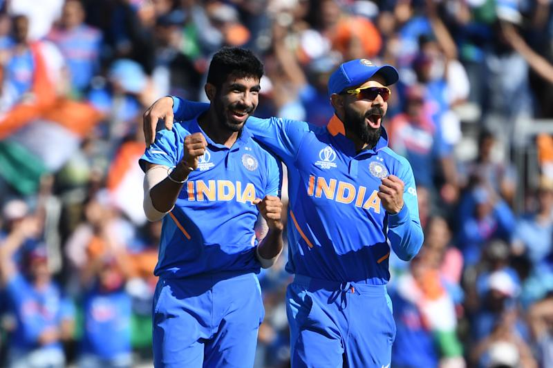 India's Jasprit (L) Bumrah celebrates with India's captain Virat Kohli the wicket of West Indies' Fabian Allen for a duck during the 2019 Cricket World Cup group stage match between West Indies and India at Old Trafford in Manchester, northwest England, on June 27, 2019. (Photo by Paul ELLIS / AFP) / RESTRICTED TO EDITORIAL USE (Photo credit should read PAUL ELLIS/AFP/Getty Images)