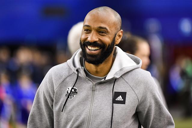 Montreal Impact head coach Thierry Henry was all smiles after winning his MLS coaching debut over the New England Revolution. (David Kirouac/Getty)