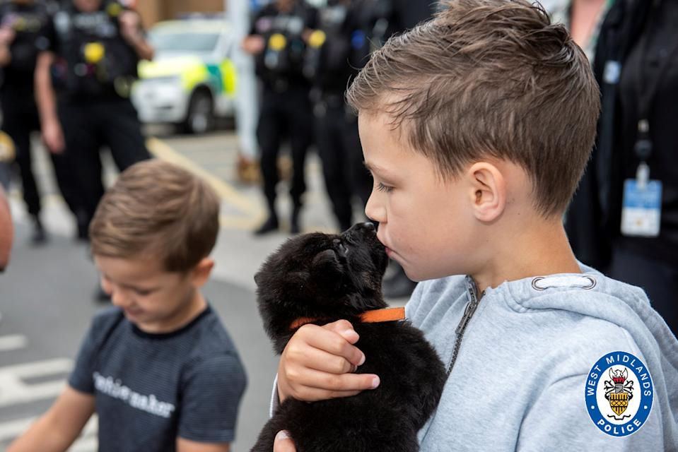Oscar also met some new puppy recruits during his visit. (SWNS)