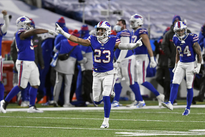Buffalo Bills' Micah Hyde (23) celebrates with teammates after an NFL divisional round football game against the Baltimore Ravens Saturday, Jan. 16, 2021, in Orchard Park, N.Y. The Bills won 17-3. (AP Photo/Adrian Kraus)