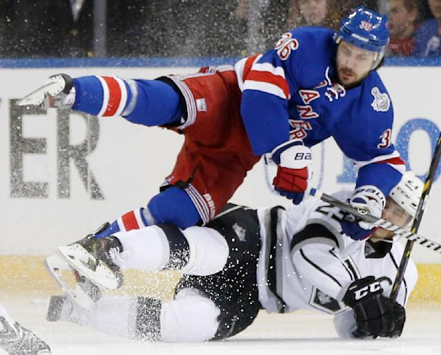 New York Rangers right wing Mats Zuccarello (36) hits the ice with Los Angeles Kings right wing Dustin Brown (23) in the second period during Game 4 of the NHL hockey Stanley Cup Final, Wednesday, June 11, 2014, in New York. (AP Photo/Kathy Willens)