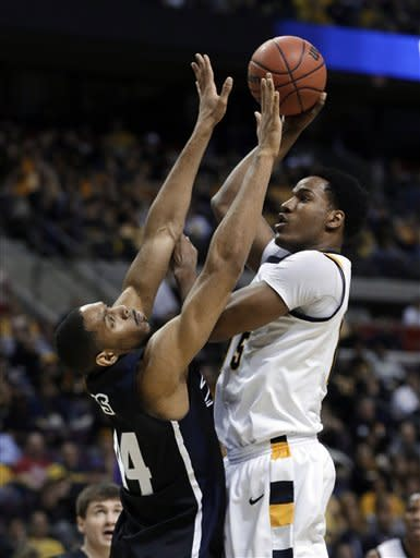 Virginia Commonwealth forward Juvonte Reddic, right, shoots over Akron center Zeke Marshall in the first half of a second-round game of the NCAA men's college basketball tournament in Auburn Hills, Mich., Thursday, March 21, 2013. (AP Photo/Paul Sancya)