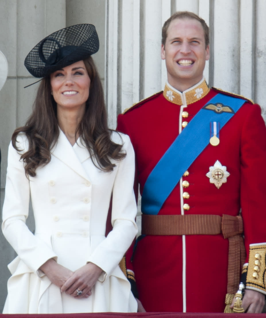 <p>Kate opted for another Alexander McQueen look for the Trooping The Colour. Dressed in a white ruffled coat, Kate accessorised with a chic black hat. </p><p><i>[Photo: PA]</i></p>