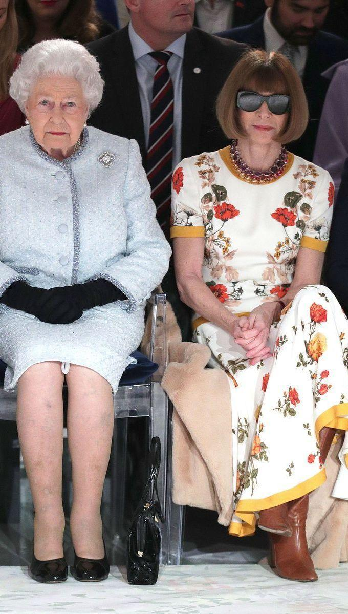 <p>Name a more iconic duo, truly I'll wait. The outfit Anna Wintour wore to sit next to the Queen is the only one you need to see—from her caramel leather boots to her dark sunglasses, it's all perfection.</p>