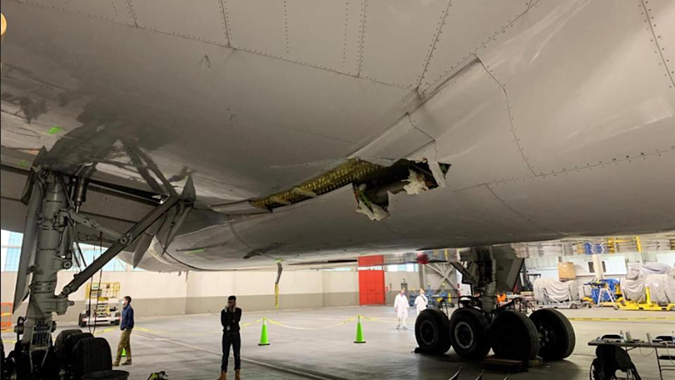 Image taken February 22, 2021, shows the damage to the wing and the body fairing of the United Airlines flight 328 Boeing 777-200 following an engine failure incident Saturday. / Credit: NTSB