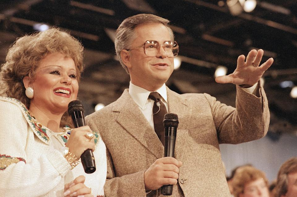 Jim And Tammy Faye Bakker are shown talking to their television audience, Aug. 20, 1986 at their PTL Ministry in Fort Mill, S.C.  (AP Photo/Lou Krasky)