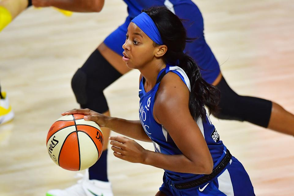 Lexie Brown dribbles the ball during a Lynx game in 2020.