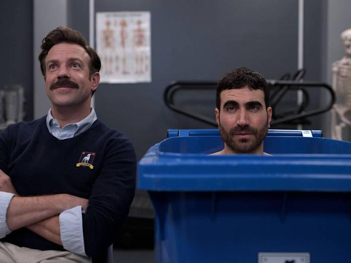 Emmy nominations went to Jason Sudeikis, left, who created and stars as Ted Lasso, and Brett Goldstein, a writer on the show who also plays Roy Kent, the mercurial team captain.