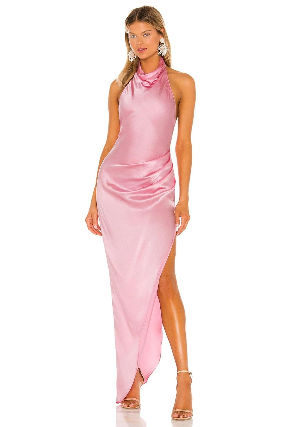 """You can keep your glam and accessories to a minimum here. Between the thigh slit, the high-neck cowl, and the subtle hip draping, this bubblegum pink gown is doing <em>all</em> the work. $321, Revolve. <a href=""""https://www.revolve.com/amanda-uprichard-x-revolve-samba-gown/dp/AMAN-WD1277/"""" rel=""""nofollow noopener"""" target=""""_blank"""" data-ylk=""""slk:Get it now!"""" class=""""link rapid-noclick-resp"""">Get it now!</a>"""