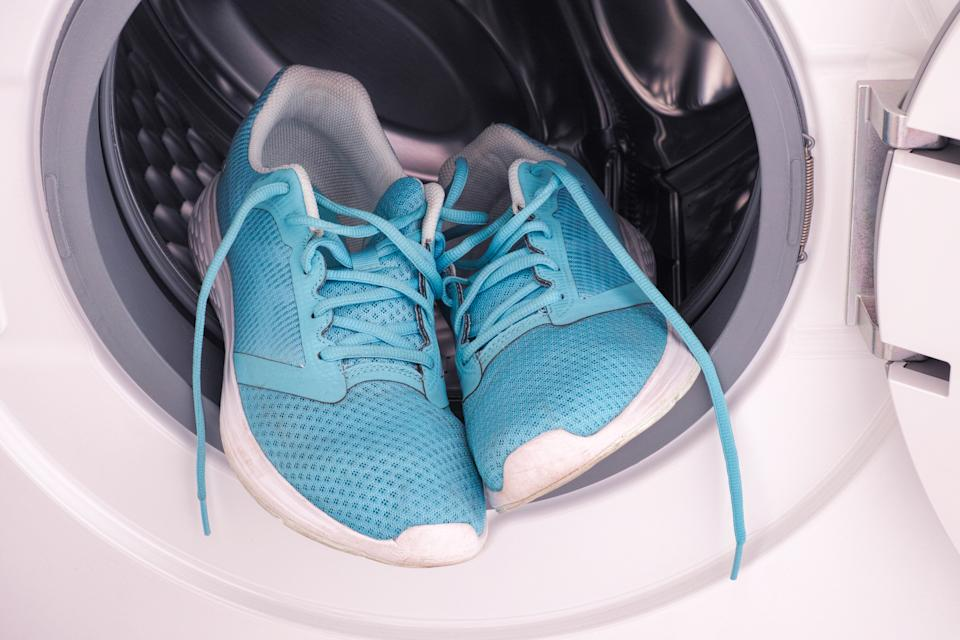 Sneakers inside the washing machine. Close up.