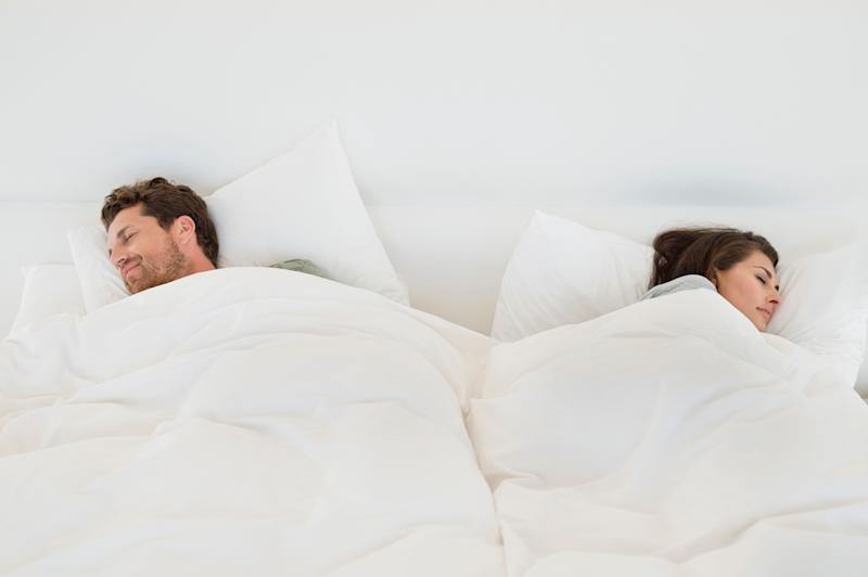 Couple sleeping on the bed
