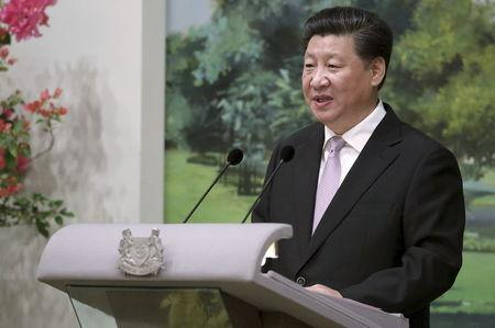 Chinese President Xi Jinping delivers a speech during a state banquet held at the Istana or presidential palace as part of his official visit to Singapore