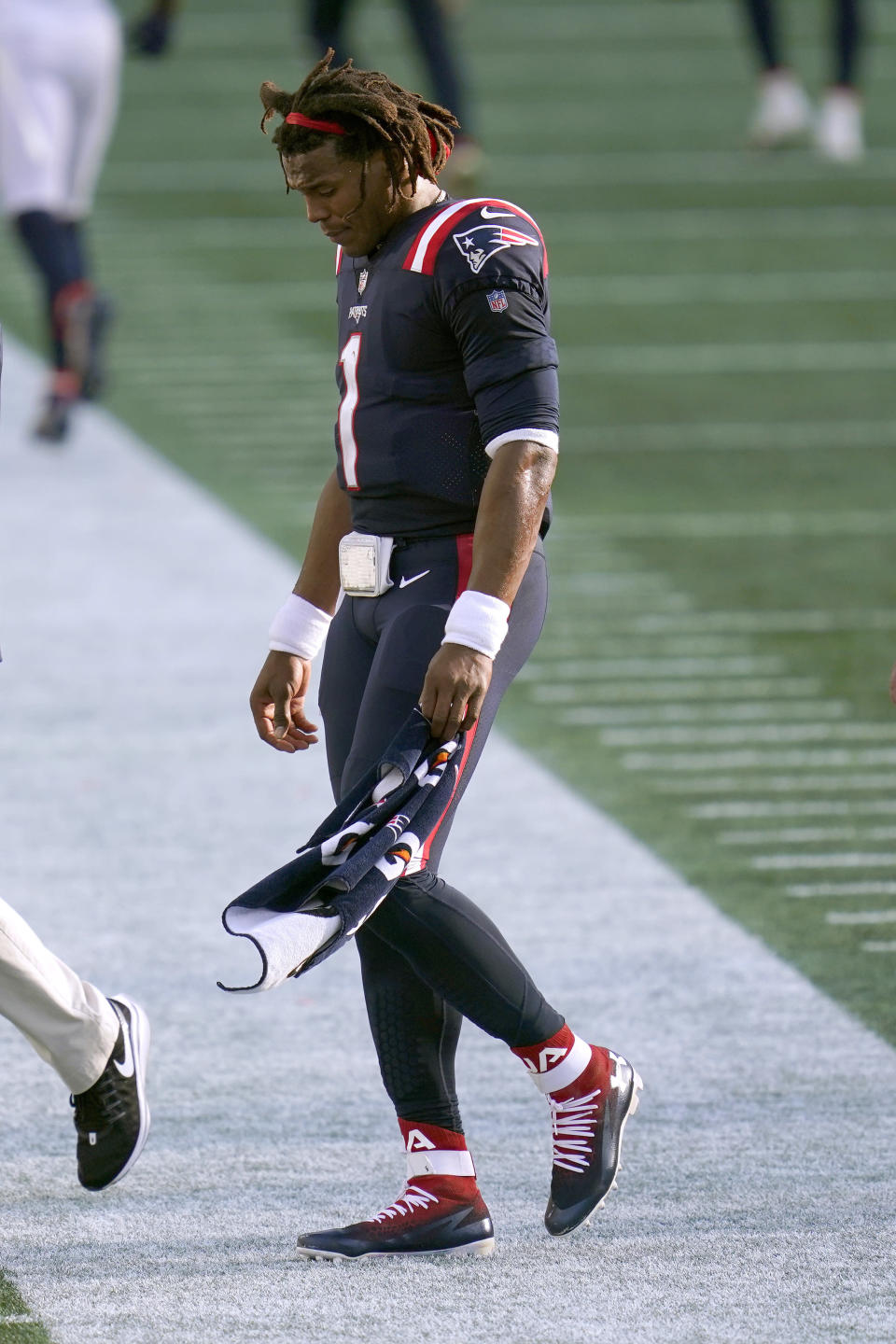 FILE - New England Patriots quarterback Cam Newton leaves the field after an NFL football game against the Denver Broncos in Foxborough, Mass., in this Sunday, Oct. 18, 2020, file photo. The Patriots released quarterback Cam Newton on Tuesday, Aug. 31, 2021, clearing the way for rookie Mac Jones to open the season as New England's quarterback, according to a person with knowledge of the move. The person spoke to the Associated Press on condition of anonymity because the decision has not been announced. (AP Photo/Charles Krupa, File)