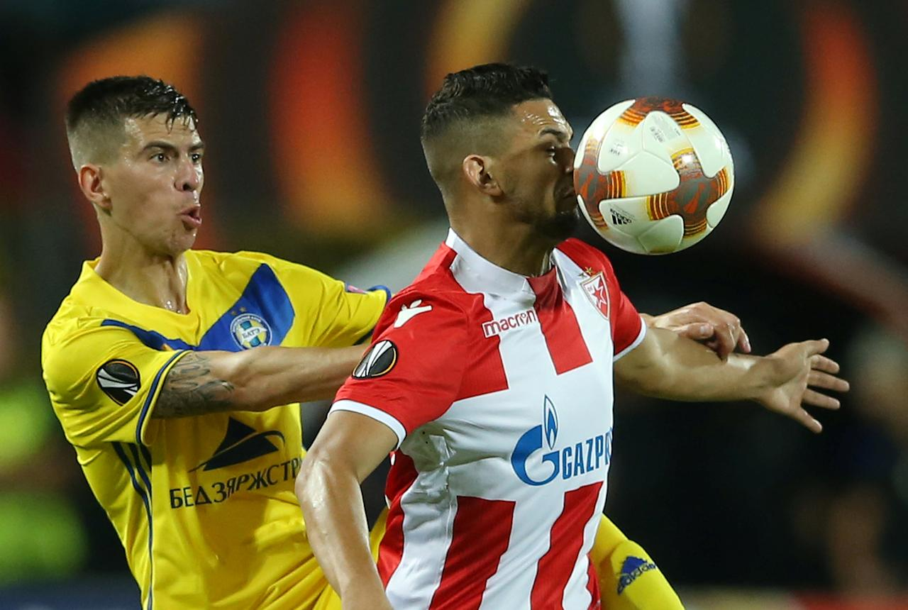 Soccer Football - Europa League - Crvena Zvezda vs BATE Borisov - Rajko Mitic Stadium, Belgrade, Serbia - September 14, 2017   BATE Borisov's Alyaksey Ryas in action with Crvena Zvezda's Ricardinho    REUTERS/Marko Djurica