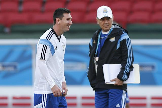 Argentina's Lionel Messi, left, stands next to head coach Alejandro Sabella during a training session at the Beira-Rio Stadium in Porto Alegre, Brazil, Tuesday, June 24, 2014. Argentina plays in group F of the 2014 soccer World Cup. (AP Photo/Victor R. Caivano)