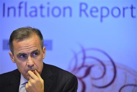 Bank of England Governor Carney listens during the bank's quarterly inflation report news conference at the Bank of England in London