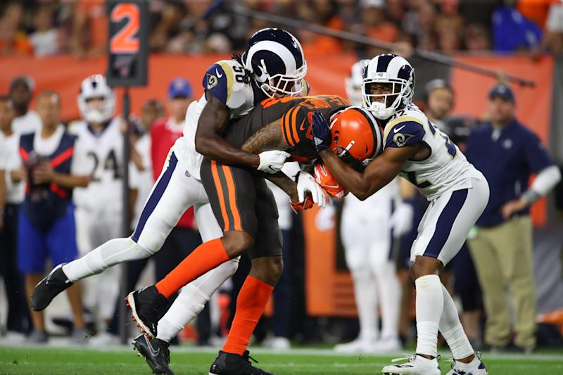 CLEVELAND OHIO- SEPTEMBER 22 Tight end Ricky Seals Jones #83 of the Cleveland Browns is tackled by inside linebacker Cory Littleton #58 and cornerback Marcus Peters #22 of the Los Angeles Rams during the second quarter of the game at First Energy Stadiu