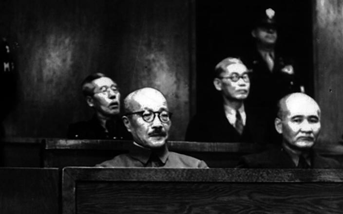 Former Army General and Prime Minister Hideki Tojo (centre) at a military trial in 1946