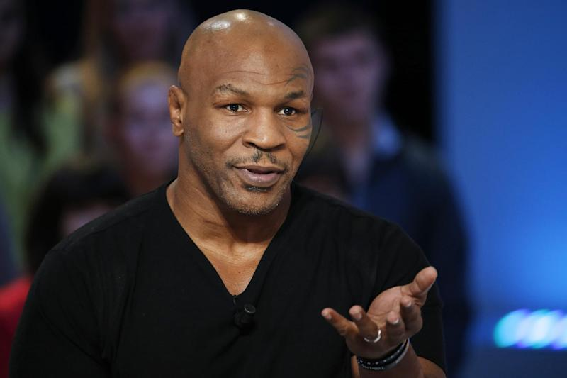 """US Former heavyweight boxing champion Mike Tyson attends the TV show """"Le Grand Journal"""" on the French television channel Canal Plus on December 9, 2013 in Paris"""