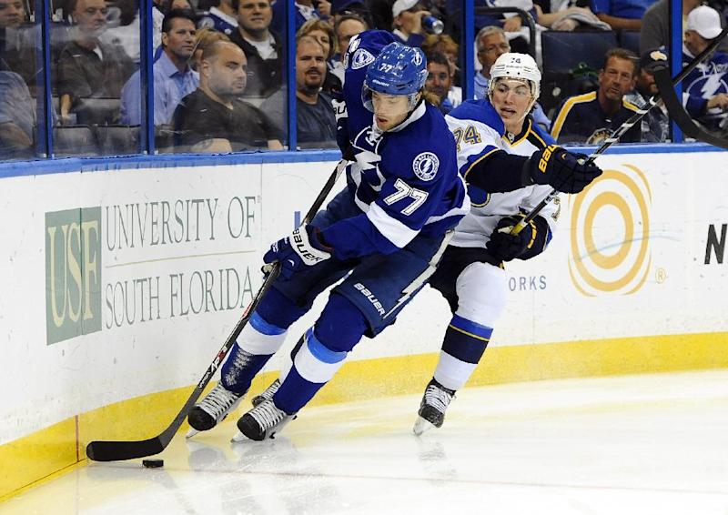 Tampa Bay Lightning defenseman Victor Hedman, left, of Sweden, controls the puck in front of St. Louis Blues center T.J. Oshie during the first period of an NHL hockey game Saturday, Nov. 2, 2013, in Tampa, Fla. (AP Photo/Brian Blanco)