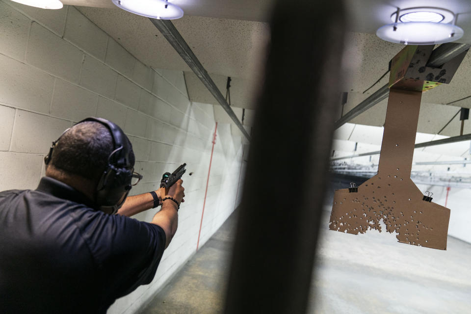 "Chad King, who started the Detroit chapter of the National African American Gun Association and teaches de-escalation training, practices at a shooting range in Taylor, Mich., Wed, Oct. 28, 2020. King started his group in 2017 to promote responsible gun ownership in the Black community. Now the nation is on edge contemplating the added threat of possible clashes in the wake of Election Day. Some of his students sought gun ownership as far right groups appear to them to have become more emboldened. Weeks ago, a group of white men were arrested for allegedly plotting to kidnap the Democratic governor of Michigan. Trump has refused to promise a peaceful transfer of power. He told a far-right group to ""stand back and stand by."" (AP Photo/David Goldman)"