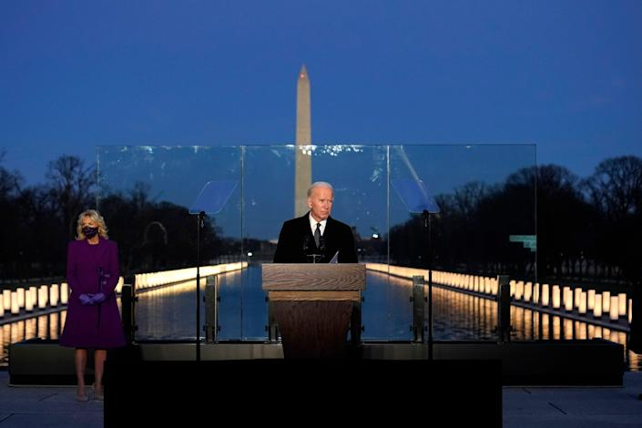 President-elect Joe Biden speaks during a COVID-19 memorial, with lights placed around the Lincoln Memorial Reflecting Pool, Tuesday, Jan. 19, 2021, in Washington (AP)