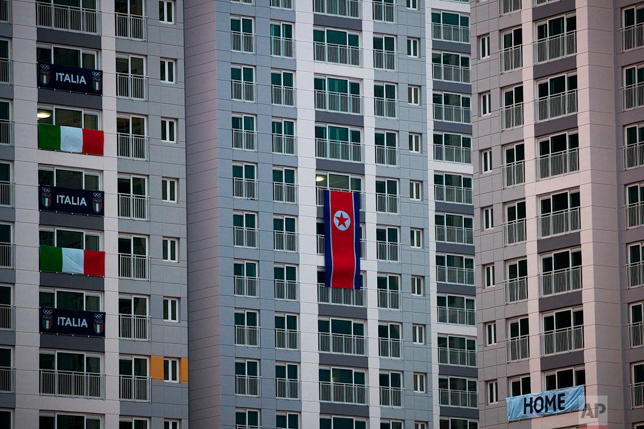 <p>A large North Korean flag hangs from an apartment building at the Olympic Village prior to the 2018 Winter Olympics in Gangneung, South Korea. (AP Photo/Jae C. Hong) </p>