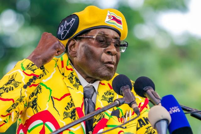 Mugabe addresses party members and supporters at his party headquarters to show support to Grace Mugabe becoming the party's next vice president after the dismissal of Emmerson Mnangagwa on Nov. 8. (JEKESAI NJIKIZANA via Getty Images)
