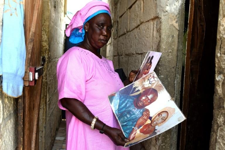 "Khady Dieye holds photographs of her husband who left the family home on Senegal's northern coast and boarded a dugout canoe in the hope of reaching Spain. Like many other would-be migrants, he disappeared, leaving his family not knowing whether he was dead or alive, stuck between hope and grief ""Since then, we have not had any news of him,"" said Dieye, who lives in the small fishing village of Ndiebene-Gandiol near Saint-Louis"