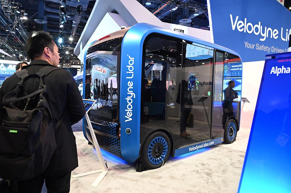 An attendee visits the Velodyne booth featuring Velodyne Lidar sensor technology, January 7, 2020 at the 2020 Consumer Electronics Show (CES) in Las Vegas, Nevada. (Photo by Robyn Beck / AFP) (Photo by ROBYN BECK/AFP via Getty Images)