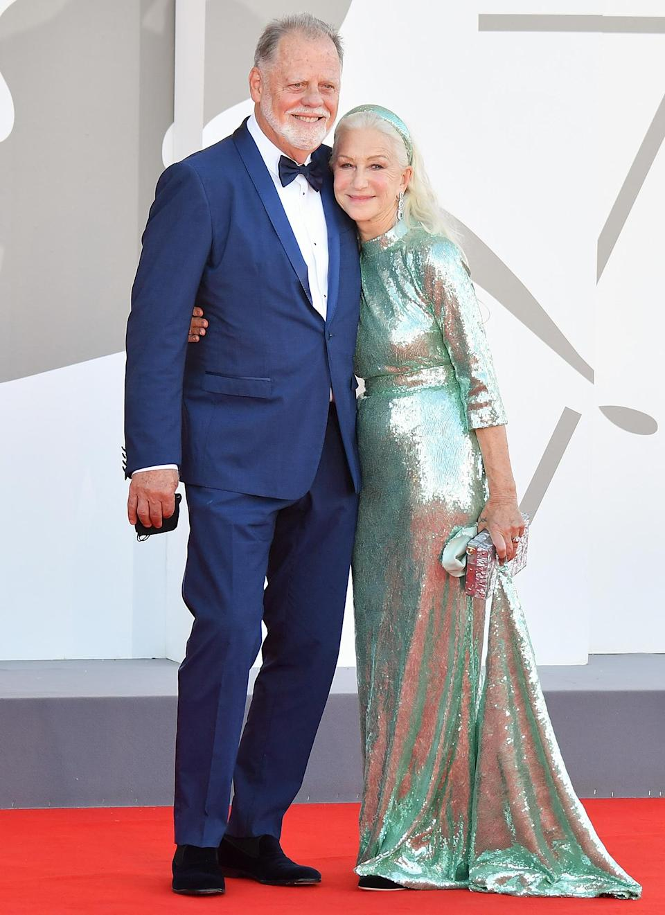 <p>Taylor Hackford and Helen Mirren embrace on the red carpet for the film <em>Madres Paralelas</em> during the 78th Venice International Film Festival on Sept. 1 in Italy.</p>