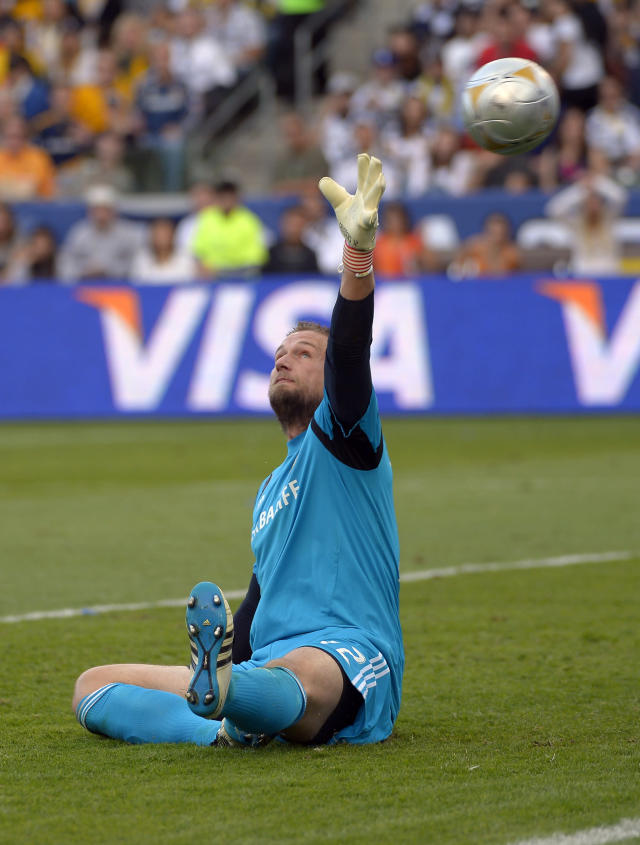 Los Angeles Galaxy goalkeeper Josh Saunders is scored on by Houston Dynamo forward Calen Carr during the first half of their MLS Cup soccer match, Saturday, Dec. 1, 2012, in Carson, Calif. (AP Photo/Mark J. Terrill)