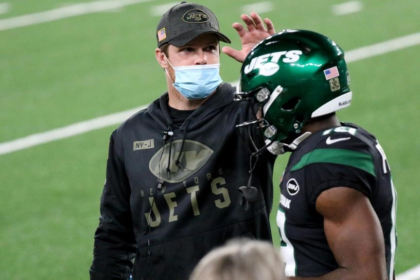 Darnold on bench with mask on