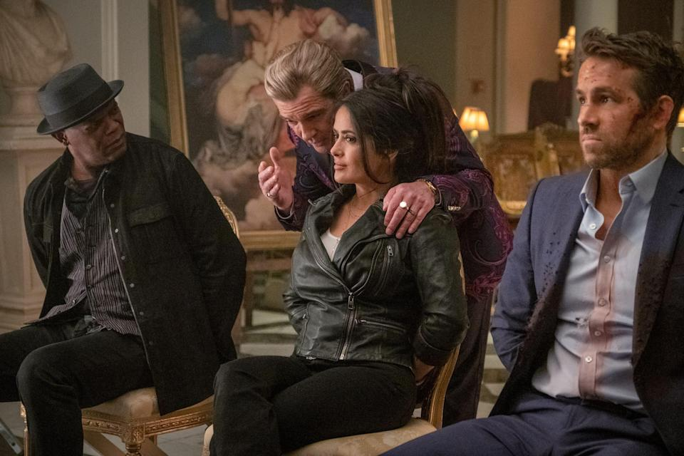 """Antonio Banderas (center) stars as a Greek villain with a nefarious plan that a hitman (Samuel L. Jackson), his wife (Salma Hayek) and a bodyguard (Ryan Reynolds) have to stop in """"The Hitman's Wife's Bodyguard."""""""