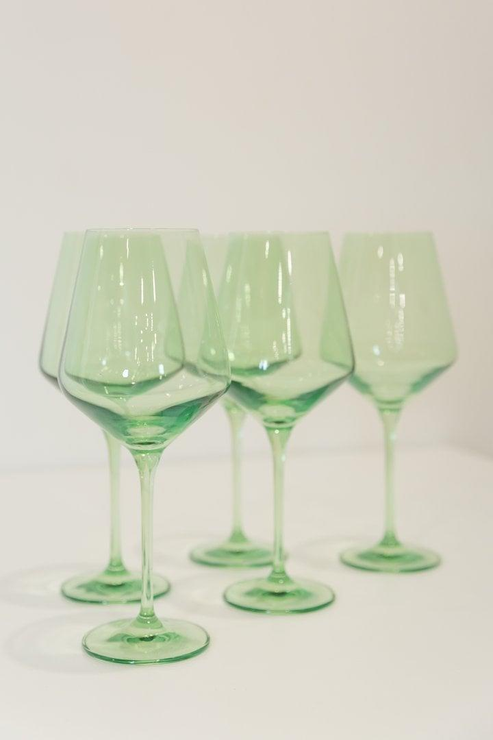 <p>We found our green wine glasses at Dobbins Street Co-op, a secondhand shop in Brooklyn, but this <span>Estelle Colored Wine Stemware, Set of 6</span> ($175) in mint green is a solid dupe. </p>