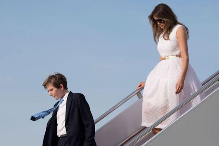 """<p>Despite her husband's move to the White House, Melania remained in New York City with Barron so he could finish out the school year. There were <a rel=""""nofollow noopener"""" href=""""https://www.redbookmag.com/life/friends-family/a48422/first-lady-melania-trump-not-move-white-house/"""" target=""""_blank"""" data-ylk=""""slk:reports"""" class=""""link rapid-noclick-resp"""">reports</a> that Melania and Barron might <em>never </em>move to D.C.</p>"""