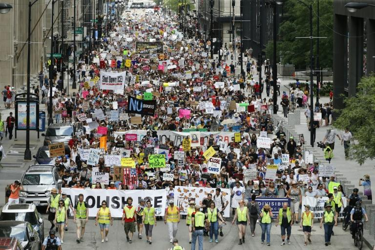 Protesters in Chicago march to the offices of US Immigration and Customs Enforcement on July 13, 2019 calling for an end to criminalization, detention and deportation of migrants ahead of planned ICE raids
