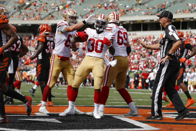 San Francisco 49ers running back Jeffrey Wilson (30) celebrates his touchdown during the second half an NFL football game against the Cincinnati Bengals, Sunday, Sept. 15, 2019, in Cincinnati. (AP Photo/Frank Victores)