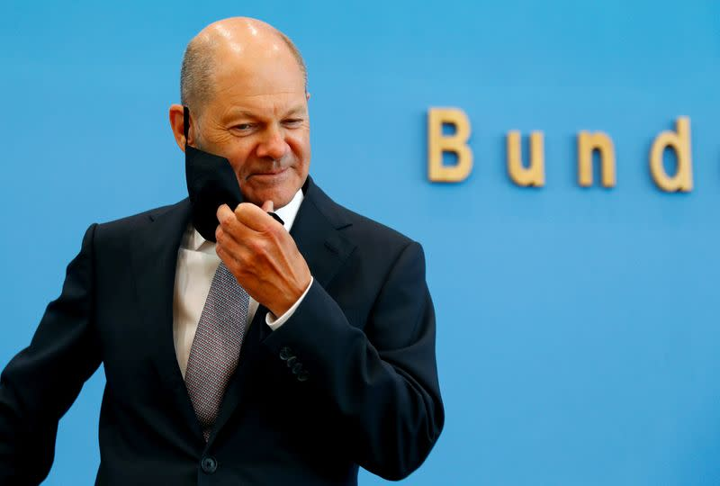 FILE PHOTO: German Finance Minister Olaf Scholz presents the federal government's 2021 draft budget, in Berlin