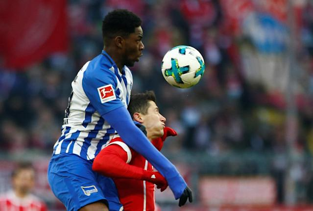Soccer Football - Bundesliga - Bayern Munich vs Hertha BSC - Allianz Arena, Munich, Germany - February 24, 2018 Hertha Berlin's Jordan Torunarigha in action with Bayern Munich's Robert Lewandowski REUTERS/Michaela Rehle DFL RULES TO LIMIT THE ONLINE USAGE DURING MATCH TIME TO 15 PICTURES PER GAME. IMAGE SEQUENCES TO SIMULATE VIDEO IS NOT ALLOWED AT ANY TIME. FOR FURTHER QUERIES PLEASE CONTACT DFL DIRECTLY AT + 49 69 650050