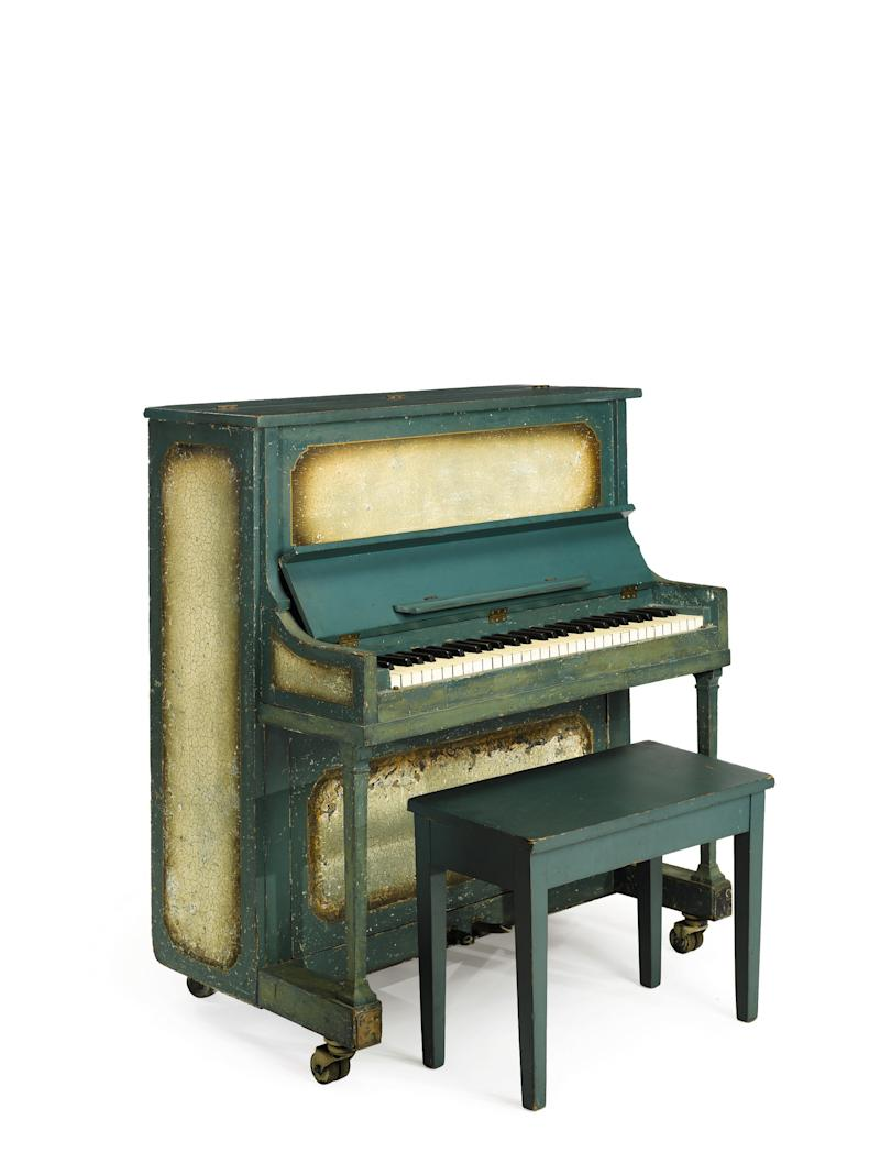 """This undated photo provided by Sotheby's shows the piano used in the movie """"Casablanca.""""  An unidentified buyer plunked down $602,500 for the piano that played """"As Times Goes By"""" in the classic 1942 film """"Casablanca.""""  The 58-key upright sold at Sotheby's New York on Friday. (AP Photo/Sotheby's)"""