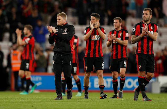 "Soccer Football - Premier League - AFC Bournemouth vs Manchester United - Vitality Stadium, Bournemouth, Britain - April 18, 2018 Bournemouth manager Eddie Howe, Steve Cook and teammates applaud fans after the match Action Images via Reuters/John Sibley EDITORIAL USE ONLY. No use with unauthorized audio, video, data, fixture lists, club/league logos or ""live"" services. Online in-match use limited to 75 images, no video emulation. No use in betting, games or single club/league/player publications. Please contact your account representative for further details."